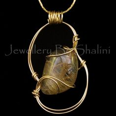 Rutilated Quartz Pendant wrapped in 14/20 Gold filled round wire. This particular pendant is a  special favourite of mine! Not just because it's so pretty but because this particular cabochon was cut and polished by me from rough.