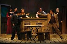Ok, this impresses me.  The scenic dept on this production found an exact match for one of the metal legged wood tables shown in the 1904 photos.  WOW.  Einstein (Jamie Torcellini) and Picasso (Paul Provenza) square off for a duel with pencils in Picasso at the Lapin Agile.