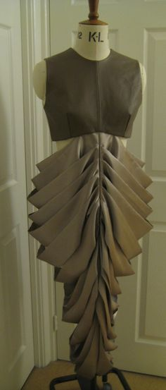 gown with fabric manipulation