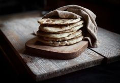 Homemade Naan - There are so many different ways you can jazz up this basic naan recipe — herbs, cheese, you name it! Use any leftover naan as a pizza crust stand-in; you'll have a tasty, no-delivery-required meal ready in no time. Pan Focaccia, Yogurt Melts, Cuisine Diverse, Tasty, Yummy Food, Mets, Food 52, Diy Food, Food Ideas
