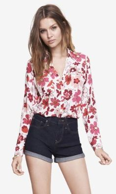 PINK 1970S FLORAL PORTOFINO SHIRT from EXPRESS This blouse is almost too whimsical for the workplace but if matched with a black suit jacket and pant or pencil skirt and a neutral shoe this shirt can be worn on a Friday.