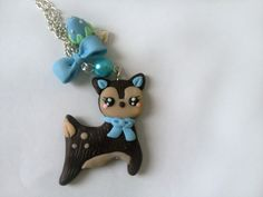 Sweet Kawaii Little Deer Necklace - Blue Fawn - Bow and Strawberry Charms - Polymer Clay Charm. $26.00, via Etsy.