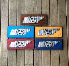 "Our Tennessee state flag has been hand cut from reclaimed barn tin and mounted on wood gathered from local Tennessee farms or fallen structures. The state tristar is painted in black and distressed by hand. Size is 18""x8"" approximate. D-ring hanger included on back fro easy display. Available to order online at www.signniche.com"