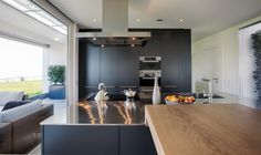 Kitchen by Poggenpohl with custom-made bar in oak wood