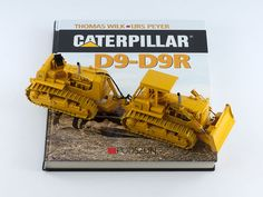 """Caterpillar D9-D9R"" [Book]  Caterpillar's D9G Track-Type Tractor, which was first introduced in 1961, is probably the most famous bulldozer in the world.  Authors Thomas Wilk and Urs Peyer's are responsible for the pictorial history of the legendary Caterpillar D9 Track-Type Tractor.   The text in the book ""Caterpillar D9-D9R"" is in German, but the 450 wonderful photographs make up about 80% its content of in total 208 pages. Published by Podszun GmbH under ISBN 9783861332909."