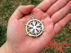 The gold and silver-plated pendant measures 3.5 cm in diameter. The silver-plated chain measures 22 inches.