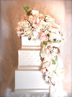 Dimensions: 12 base tier, 10 middle tier, 8 top tier, with floral arrangement 24-26 high Covered in ivory fabric, this wedding box is topped with a soft pinks, peaches and cream floral arrangement with complimentary fillers. Flowing down the side of this card box is a same fabric swag