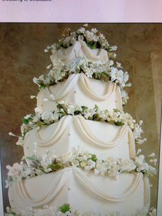 Wedding Cake from Sugar Bakers Cakes in Catonsville, MD - love traditional white/ivory wedding cakes with fondant Swags