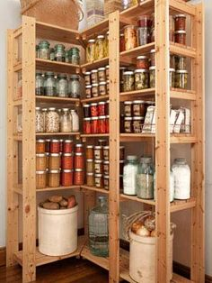 Ways to Sneak Storage into your home | take advantage of vertical space six-foot-tall pine shelving units that also maximize corners