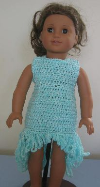 This crochet pattern for an American girl doll dress is fairly simple to make. It has a simple neckline, is sleeveless sleeved and closes in back with the aid of snaps. (Dress is opening entire length in back) The Fringe is added once the dress is completed and done in varying lengths.