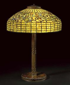 TIFFANY STUDIOS A 'SWIRLING OAK LEAF' LEADED GLASS AND BRONZE TABLE LAMP, CIRCA 1910 | Christie's