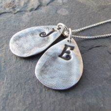 These fine silver fingerprint charms are a priceless piece of jewelry.  The fingerprints are made from precious metal clay, heated in the kiln, and then finished in a tumbler for a great finish MEMBER - Pam Hurst Designs