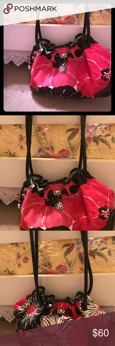 Brighton Red and Pink Flowered Canvas Purse This beautiful bag has been carried one time. It's just not my style. It has leather corners, handles, and trim. The bag is generous in size and can hold any woman's life. This beauty is perfect for the coming Fall season! Brighton Bags Shoulder Bags