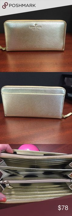 """Kate Spade Lacey Gold Wallet Brand new never used KS Lacey gold zip around wallet. I do not have the tags or box. I purchased this for my daughter who ditched the tags & box as soon as she opened it. Unfortunately it's not her style. Wallet measures 4"""" tall and 7.5"""" long. Style# PWRU 4065. There are 12 card slots, 2 billfold slots & a zippered pouch for change. There is also a billfold slot on the backside. kate spade Bags Wallets"""