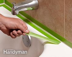 Remove the tape after tooling the bead, and then you're done recaulking the shower. - How to Re-caulk a Shower or Bathtub: http://www.familyhandyman.com/bathroom/remodeling/how-to-re-caulk-a-shower-or-bathtub/view-all
