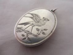 ANTIQUE c1890 VICTORIAN STERLING SILVER BIRD DOUBLE PENDANT LOCKET