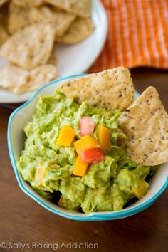 Simple Mango Guacamole - try this tangy, sweet, and spicy guacamole the next time you're craving the creamy dip. Perfect accompaniment to your favorite tortilla chips!