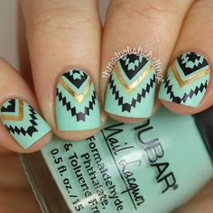 Cute Aztec nails in teal gold and black.