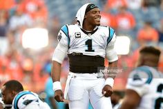 Quarterback Cam Newton #1 of the Carolina Panthers smiles before taking on the Denver Broncos at Sports Authority Field at Mile High on September 8, 2016 in Denver, Colorado.
