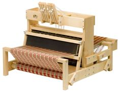 "This beautiful 8-harness table loom (15"") from Schacht are great for classrooms, workshops, sampling and small projects. They are ideal to learn on and allow for infinite experimentation. Schacht tabl"