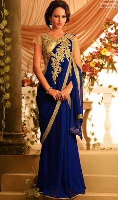 Flaunt your style with this beige and royal blue embroidered chiffon georgette gown. This lovely gown is showing some terrific embroidery done with gold zardosi, resham, sequins and stones work. #AwesomeDesignerGown