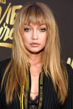 For an anxiety-free update to your hair, add clip-on bangs like Gigi Hadid.