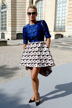 French model and actress Estelle Lefebure poses during a photocall prior to Christian Dior 2014 Spring/Summer ready-to-wear collection fashion show, on September 27, 2013 in Paris. AFP PHOTO / PATRICK KOVARIK