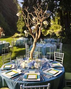 Cornflower Blue Wedding Table with Branches Centerpiece. Beautiful! Look at the menu cards, square instead of circle. If you don't want menu cards, just write a thank you...