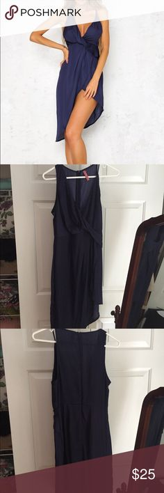 Hello Molly Clap Your Hands Dress Navy Hello Molly navy dress. Worn once for a wedding- still in perfect condition. Size 8 AUS which is a small in US sizes. Hs a v-shaped neckline, contrasting straps and an asymmetrical hemline to show off those legs. There is also an invisible zip through the back. Pop on a corset style waist belt to cinch your look to perfection! The Blossom Apparel Dresses Asymmetrical