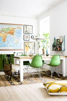 Home office with green chairs and maps on wall