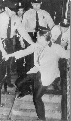 Elvis escapes a hoard of fans with help of police, 1950's