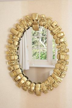 take the old toy cars and paint them all a similar color ( in this instance, gold) and use them to border an old mirror....