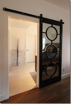 mbr closet door ideaa sliding barn door with circle insets over mirror adds style while bouncing light back into the room