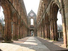 Jedburgh Abbey lies on south facing slopes on the north bank of the Jed Water, close to the centre of Jedburgh. It was founded, initially as a priory, by King David I in 1138. His intention was partly to demonstrate to the English that the  Scots could build on a grand scale so close to the oft disputed border between the two countries. In doing so he was tempting fate and the English: and both failed to resist the temptation many times over the following four centuries.