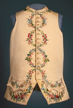 Gentleman's waistcoat in ivory silk faille with embroidery on collar, pockets, center fronts and lower edge. Embroidered in 22 shades of silk with floral garlands which form circles down the center front when the waistcoat is buttoned.