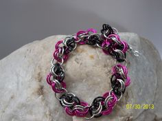 "Hot pink, black and silver ""Trade Winds"" - $30.00 I have many more items for sale at Shejewelry Culbertson on Facebook. Please pay me a visit!"