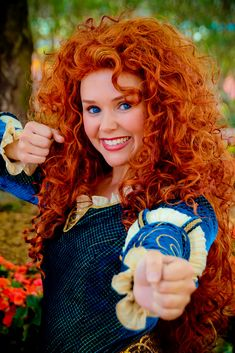 I don't know if that's a wig or not, but that's the most gorgeous head of hair I've ever seen.  Merida from Brave