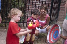 super hero games/activities - strong man, flash, capt america (fend of rubber bullets), wonder woman's lasso - hula hoops around standing object