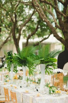 2017 Pantone Color of the Year: Greenery | There's nothing quite as appropriate for summertime event or beach wedding as tropical details. If you're not about flowers, lush arrangements of palm leave and fern adds lots of texture, vibrance and beachy flair to any tablescape.