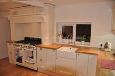 Painted Farrow and Ball Painted shaker Kitchen with Smeg Range cooker and FAB fridge, Solid Oak worktops and Belfast Sink