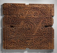 An early century Abbasid wood panel beautifully decorated with a Seal of Solomon and other carvings. Probably from Baghdad, this panel functioned as a talisman, as was common on architectural surfaces in Muslim art. Currently at the MET Museum - New York. Islamic World, Islamic Art, Seal Of Solomon, Roman Art, Star Of David, Animal Fashion, Art And Architecture, Islamic Architecture, Ancient Art