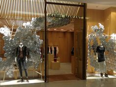 Isabel Marant aluminum plates windows by Arnold Goron visual merchandising: great use of reflective surfaces to look chic and modern!