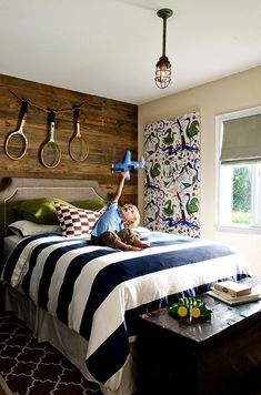 Loving the wood plank/blue-and-white/neutral walls scheme in a boy room! Cute!
