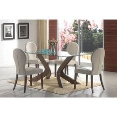 This five-piece dining set features warm upholstery, a dark walnut finish and functional details. A beveled edge lines the glass top perimeter of the dining table. Shapely pedestals offer leg room and artistic relief around this dining table.
