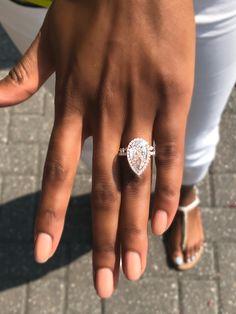 pear shaped diamond engagement rings | pear shaped ring with diamond halo | halo engagement rings | rose gold engagement rings | #pearshapedring #engagementrings #diamonds #diamondjewelry #diamondsdirect | Diamonds Direct engagement rings