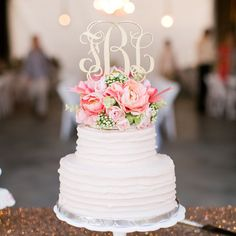 Simple cake with beautiful floral topper and classic monogram.
