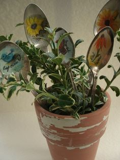 Looks like decoupage on spoons plant markers or just art for the garden!