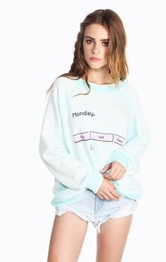 It's Monday so cry, eat, sleep in Kim's Sweater, which features a crewneck, banded hems and a roomy, relaxed fit. Constructed from a soft and warm Sherpa fleece. In Salt Water Taffy Green. Features a computer graphic in pink on the front of the top. 30% Cotton, 70% Polyester  Model wears a size small.