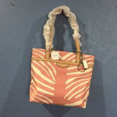 COACH ZEBRA TOTE Pink Tuille/Tan Great bag! On sale until December 2.  Dimensions: 10h x 4w x 10l. Still has paper protection on leather handles and leather tassel in zipper closure. Pristine condition! Coach Bags Shoulder Bags
