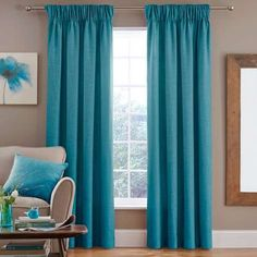 Finished in rich teal blue with a linen effect, these fully lined ready made…
